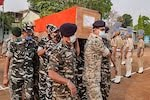 Forces carry a body of their colleague killed in the Maoist attack in Chhattisgarh